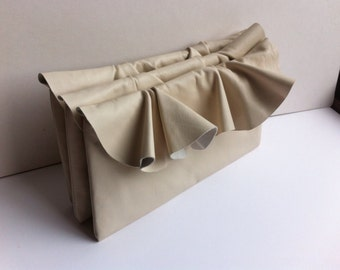 Leather ruffle clutch bag in cream