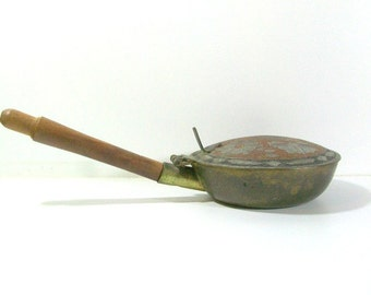 Vintage brass plated silent butler, crumb catcher, bed warmer. Made in India