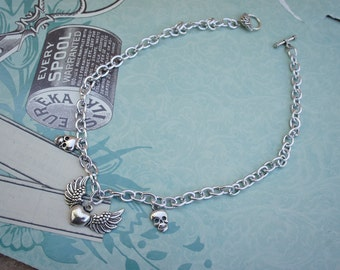Olivia Paige - Silver heart  skulls rockabilly necklace