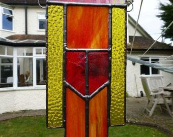 Stained Glass sunshine yellow, orange and iridescent red prairie-style suncatcher