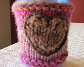 Multi-coloured pink knitted coffee/ tea travel mug cozy with heart embroidery