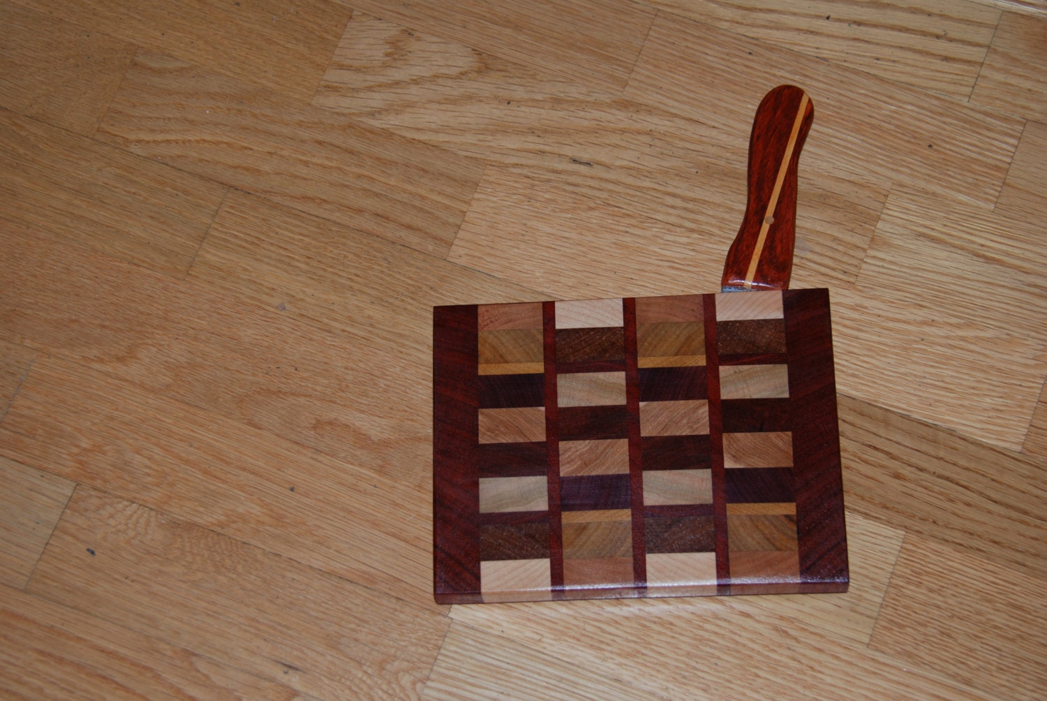 Laminated wood cheese cutting board with knife
