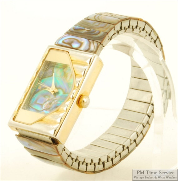 LA Express by Miyota quartz ladies vintage wrist watch, 1 Jewel, heavy gold-toned & stainless steel rectangular case, blue paua shell dial