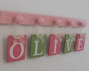 OLIVE Nursery Decorations Wooden Letters. Includes 5 Pegs and Custom Baby Name Planks Painted Light Green and Pinks Personalized Baby Gift