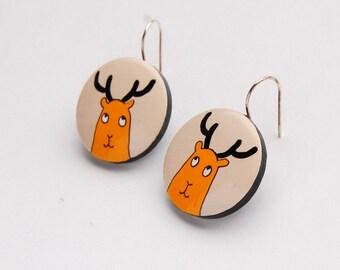 Cream dangle earrings with orange deer