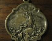 St. Jude religious medallion