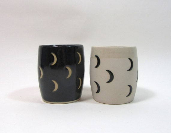 Pair of crescent moon cups, black and unglazed