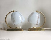 Pair of Vintage Midcentury Art Deco Style Table Lamps. Baby Blue Marbled Glass Globe Shades with Gold Metal Bases.