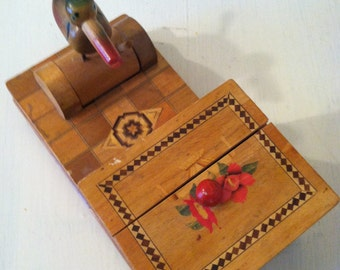 Vintage wooden cigarette box with a mechanical bird