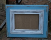 Light blue beach, baby distressed 5 x 7 with off white trim distressed frame