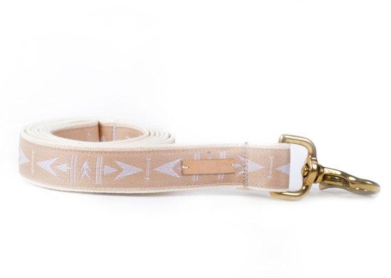Light brown dog leash, brass hardware, arrow pattern, cotton webbing