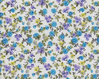 Silky cotton lawn floral with tiny blue and lavendar flowers