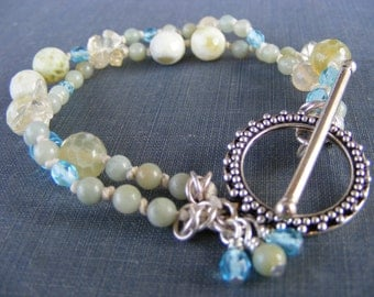 Breath of Spring Double Strand Bracelet:  Hand knotted Shades of Pale Green Yellow and Blue Gemstone Czech Glass and Silver