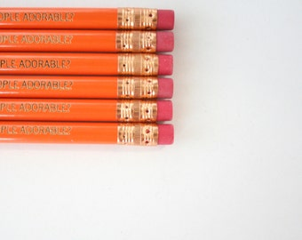 aren't ordinary people adorable 6 engraved orange pencils. for when you want a commoner for your housepet.