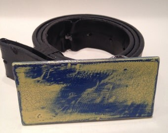Distressed steel belt buckle blue and yellow.