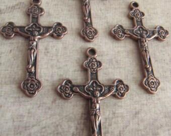 Antique Copper Crucifixes - set of 4