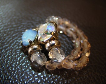 hand made nylon wire double ring with swarovsky crystalls and opal.