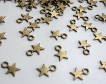 50 Tiny star charms antique bronze 11x8mm DB23147