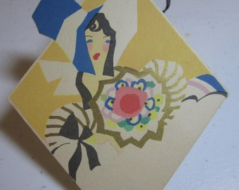 Art deco 1920's die cut  gold gilded unused Buzza bridge tally card southern belle in huge blue bonnet holding deco bouquet