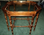 Vintage Faux Bamboo Style Fretwork Wooden Table, with machine lathe carved wooden spindled legs and glass insert top in original condition.