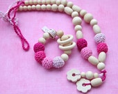 Pink colors set of 2. Teething ring toy and nursing necklace. Light pink, bright pink, berry rattle for baby and mom.