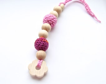 Pink small floral teething for baby. Natural wooden toy with organic cotton.