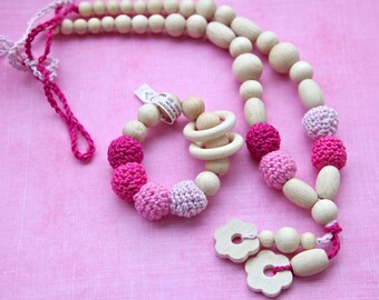 Teething ring toy and nursing necklace.  Pink colors set of 2 for baby and mom. wooden rattle for baby.