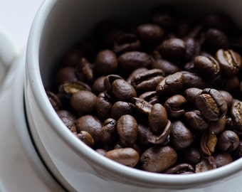 Organic Fair Trade East Timor Beans  notes of butterscotch, pipe tobacco and molasses.