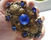 Beautiful Vintage Brass and Blue Rhinestone Ornate Hinged Cuff Bracelet Floral Design