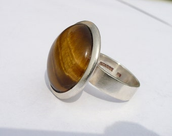 sterling silver adjustable ring with round tiger eye