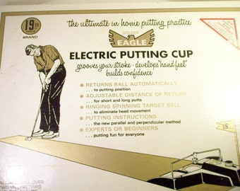 19th Hole Eagle electric golf putting cup with box 1969