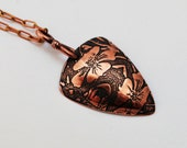 Etched Floral copper triangle pendant, oxidised and domed