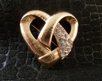 Rhinestone and gold toned heart brooch.