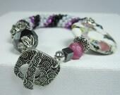 Reserved For Roger10 - Violet, Black & White, Spiral Beaded Crochet  Bracelet, Purple Bracelet
