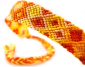 Orange Gradient Boho Tribal Summer Friendship Bracelet - handwoven thin macrame wrist band with yellow and orange knotted string