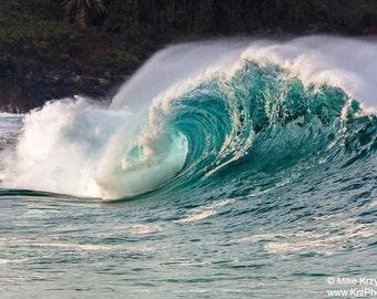 Big Hollow Wave Breaking at Waimea Bay Shorebreak on the North Shore of Oahu in Hawaii