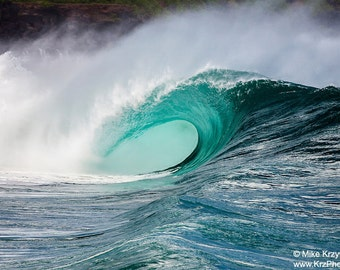 Big Hollow Wave Breaking at Waimea Bay Shorebreak on the North Shore of Oahu in Hawaii