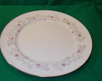 "One (1), Porcelain 10 3/8"" Dinner Plate, from Patricia, in a Floral and Scroll Pattern."