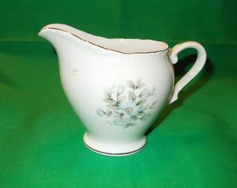 "One (1), 8 oz Porcelain Creamer, from ""M"" China, in the Arlene 3559 Pattern"