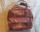 Vintage travel bag brown dark rolls wheels double handle vacation bag by Totes