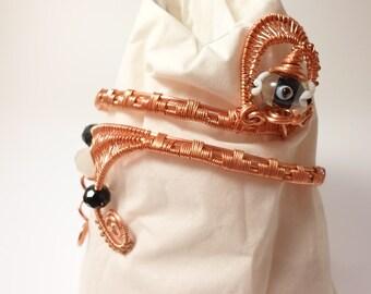 Adjustable black/ copper armwrap, bracelet cuff