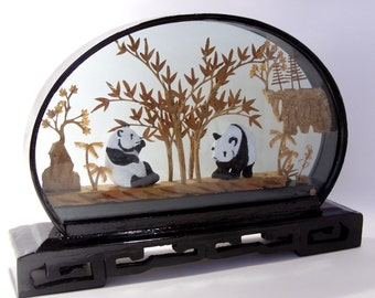 Chinese Cork Carved Picture Diorama of Two Giant Pandas in a Black Lacquer Frame