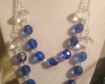 Blue beaded necklace on silver chain