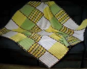 SHELL AFGHAN in spring colors to accent your favorite room and to cuddle with.