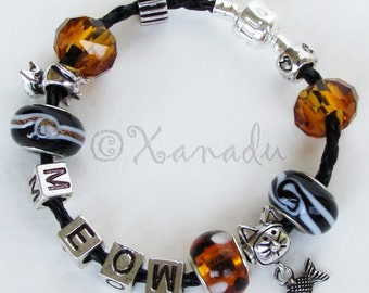 Cat Charm Bracelet - Amber Black Brown Beads With Silver Cat Charms On European Black Leather Bracelet