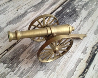 Vintage bronze colored cannon