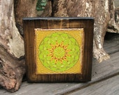 mandala in yellow color little picture on old wood