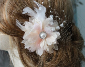 Peach   color    flower  clip with white color feather