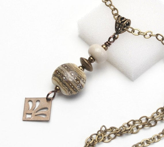 Silver Streaked Dark Ivory Pendant Necklace - Artisan Lampwork Glass Pendant with Natural Brass Beads and Fleur de Lis Charm