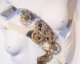 Exploded  figurative female torso with gears and clockworks